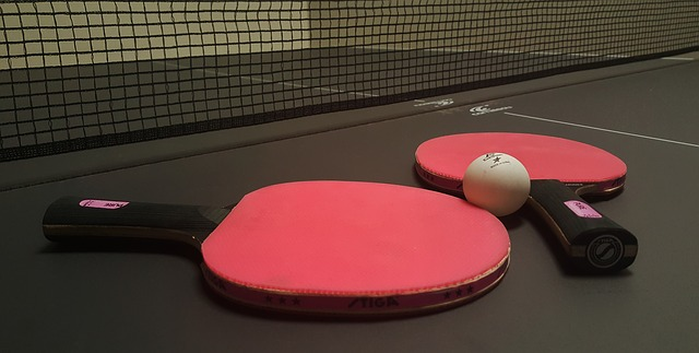 Table tennis bats and ball.