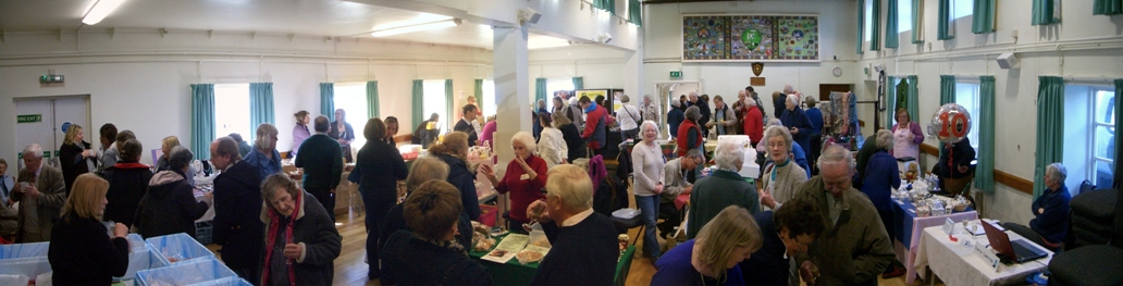The market taking place inside the Village Hall