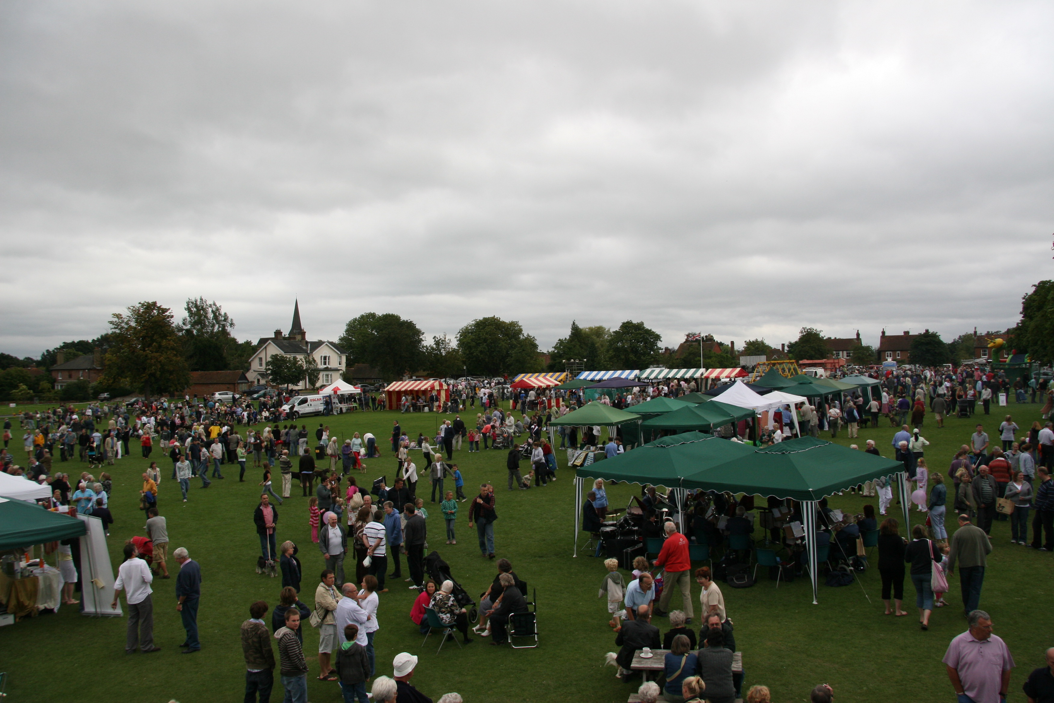 A busy August Fete with dog show and different activity stalls.