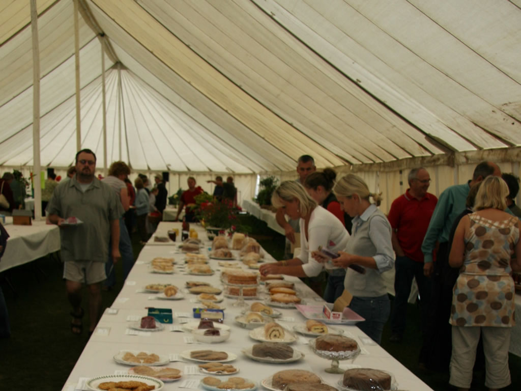 A table of exhibits in the marquee at the August Show.